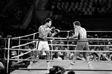 (FILES) This file photo taken on October 30, 1974 shows Former world heavyweight champion Muhammad Ali (L) and titleholder US George Foreman (R) fighting on October 30, 1974 in Kinshasa, Zaire during their world heavyweight championship match. Ali won by knocking out Foreman in the eighth round. Heavyweight boxing legend Muhammad Ali, an icon of the 20th Century whose fame transcended the sport during a remarkable career that spanned three decades, died June 3, 2016, his family said. / AFP PHOTO / -