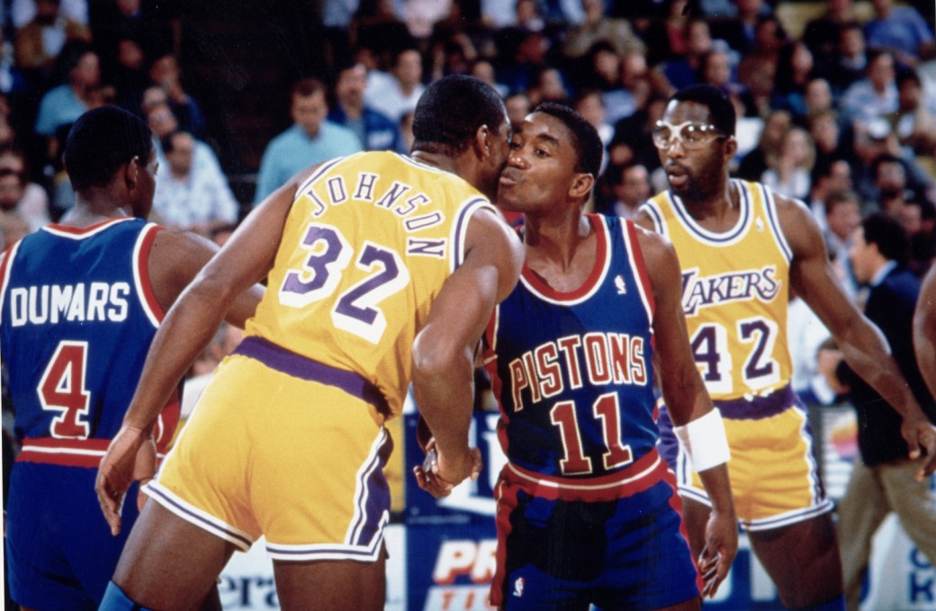 AUBURN HILLS, MI - 1990: Isiah Thomas #11 of the Detroit Pistons kisses Magic Johnson #32 of the Los Angeles Lakers circa 1990 at the Palace of Auburn Hills in Auburn Hills, Michigan. NOTE TO USER: User expressly acknowledges and agrees that, by downloading and or using this photograph, User is consenting to the terms and conditions of the Getty Images License Agreement. Mandatory Copyright Notice: Copyright 1990 NBAE (Photo by NBA Photos/NBAE via Getty Images)